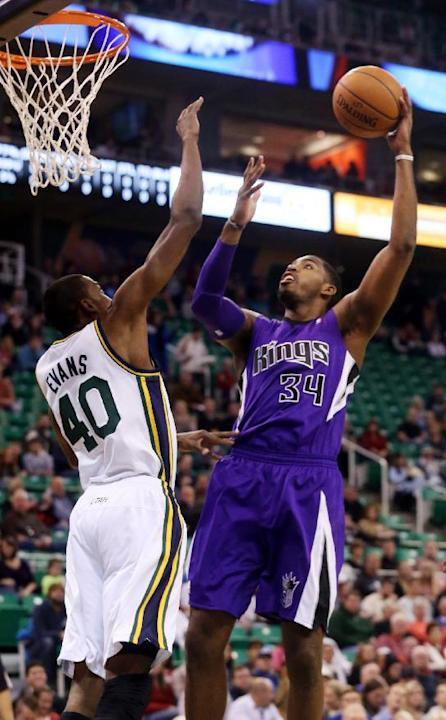 Utah Jazz's Jeremy Evans (40) defends as Sacramento Kings' Jason Thompson (34) shoots the ball in the first half of an NBA basketball game on Saturday, Dec. 7, 2013, in Salt Lake City