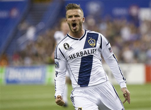 Beckham scores on free kick, Galaxy tie Impact 1-1