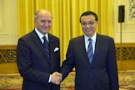 "French Foreign Minister Laurent Fabius (L) meets with Chinese Vice Premier Li Keqiang at the Great Hall of the People in Beijing. Fabius wrapped up a visit to Beijing on Tuesday, saying he hoped for a ""higher quality partnership"" between France and China"