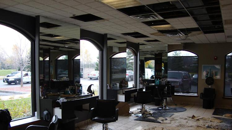 This undated file photo provided by the Brookfield Police Dept. shows the scene at Azana salon and spa in Brookfield, Wis. after Radcliffe Haughton fatally shot three people, including his estranged wife, and wounded four others before killing himself on Oct. 21, 2012. Haughton asked a taxi driver for advice on how to handle his wife on his way to the salon where he shot seven people before killing himself, according to the Brookfield Police Department, which released hundreds of pages of police reports on Friday, March 1, 2013, as well as 911 calls and security video. (AP Photo/Brookfield Police Dept., File)