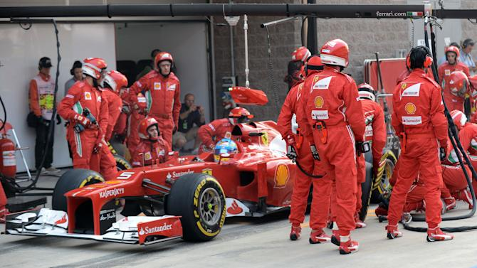 Ferrari driver Fernando Alonso of Spain steers his car out of pit lane after a tire change during the Korean Formula One Grand Prix at the Korean International Circuit in Yeongam, South Korea, Sunday, Oct. 14, 2012.  (AP Photo/Roslan Rahman,Pool)