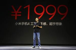 Lei Jun, founder and CEO of China's mobile company Xiaomi, announces the price of the new Xiaomi Phone 4 at its launching ceremony, in Beijing