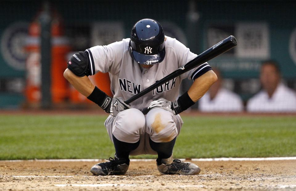 New York Yankees' Ichiro Suzuki squats at the plate as he steps up bat against the Seattle Mariners in the fourth inning of a baseball game Monday, July 23, 2012, in Seattle. (AP Photo/Elaine Thompson)