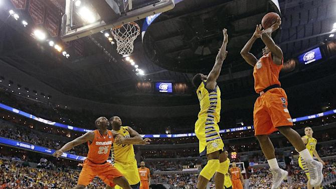 Syracuse forward C.J. Fair (5) shoots over Marquette forward Jamil Wilson (0) during the second half of the East Regional final in the NCAA men's college basketball tournament, Saturday, March 30, 2013, in Washington. (AP Photo/Pablo Martinez Monsivais)