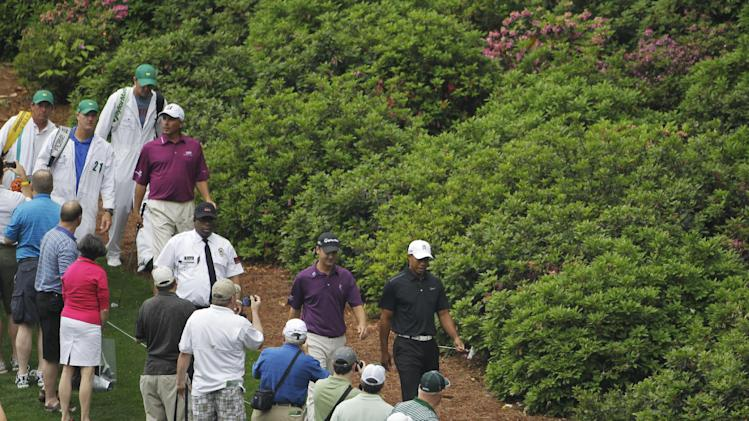 Tiger Woods, right, walks with Sean O'Hair to the sixth tee during a practice round for the Masters golf tournament Tuesday, April 3, 2012, in Augusta, Ga. At left is Fred Couples. (AP Photo/Darron Cummings)