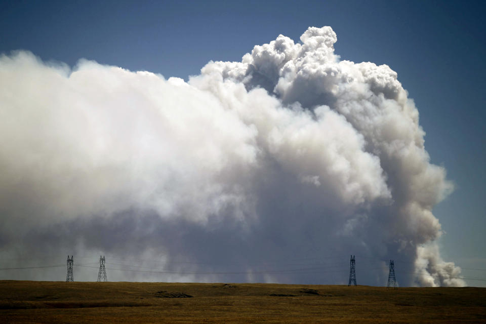 Smoke is visible from Tie Siding, Wyo., as a wildfire burns northwest of Fort Collins, Colo., on Saturday, June 9, 2012. The cause of the fire is not yet known. (AP Photo/Laramie Daily Boomerang, Andy Carpenean)