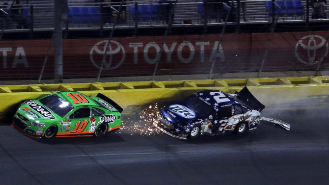 Danica Patrick (10) and Brad Keselowski (2) collide in Turn 3 during the NASCAR Sprint Cup Series Coca-Cola 600 auto race at the Charlotte Motor Speedway in Concord, N.C., Sunday, May 26, 2013. (AP Photo/Gerry Broome)