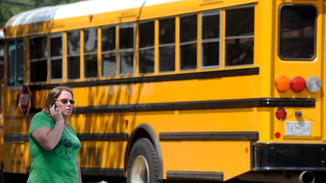 Becky Hobgood tries to locate her daughter after a student was shot and critically wounded on the first day of classes Perry Hall High School, Monday, Aug. 27, 2012, in Perry Hall, Md. A suspect was taken into custody shortly after the shooting, according to police. No one else was reported injured. (AP Photo/Steve Ruark)