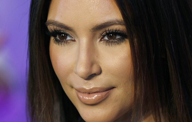 FILE - In this Oct. 4, 2012 file photo, television personality Kim Kardashian poses for photographers at the red carpet during the 40th anniversary of Cosmopolitan magazine in Spanish in Mexico City. Kanye West announced at a concert in Atlantic City Sunday night, Dec. 30, 2012 that his girlfriend Kardashian is pregnant. (AP Photo/Marco Ugarte, File)