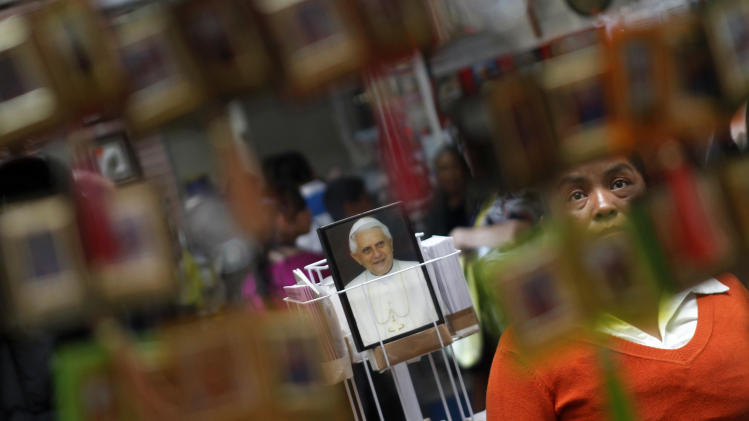 A woman looks at religious articles at a shop in the Basilica of Guadalupe in Mexico City