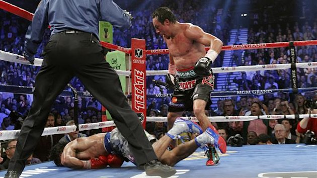 Juan Manuel Marquez (R) of Mexico steps away after knocking out Manny Pacquiao of the Philippines at the MGM Grand Gardens Arena, Las Vegas