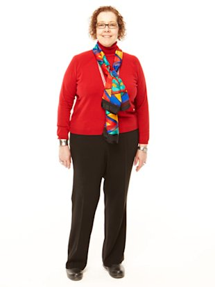 apple shaped woman in red top scarf and black pants