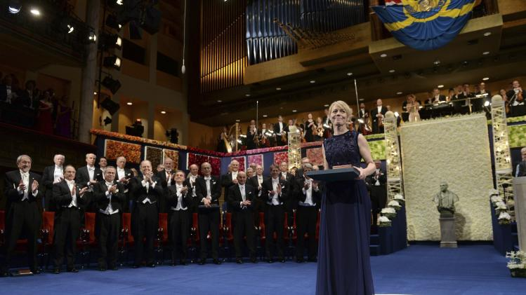 Jenny Munro, daughter of Canadian author Alice Munro, collects her mother's Nobel Prize in Literature during the 2013 Nobel Prize award ceremony in Stockholm