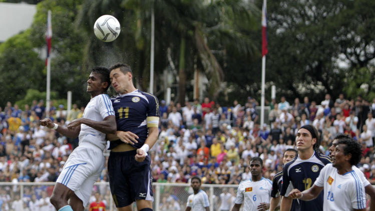 The Philippines' Alexander Borromeo (11) and Sri Lanka's Lankesara Kolitha C.K. battle for the ball during the FIFA World Cup Qualifying match Sunday July 3, 2011 in Manila, Philippines. The Philippines won 4-0 to advance for the next round against Kuwait. (AP Photo/Bullit Marquez)