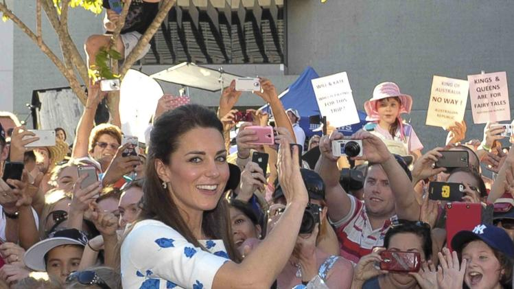 Catherine, Duchess of Cambridge, waves to members of the public after attending a reception at the Brisbane Convention & Exhibition Centre in Brisbane