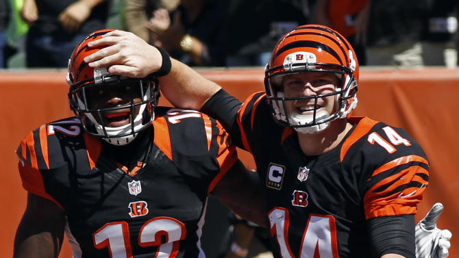 Bengals stay unbeaten with 33-7 win over Titans