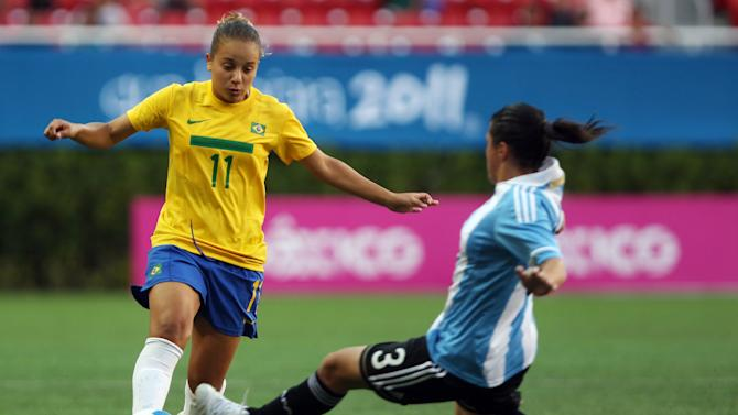Brazil's Thais Guedes, left, is challenged by Argentina's Gabriela Barrios during a women's soccer match at the Pan American Games in Guadalajara, Mexico, Tuesday Oct. 18, 2011. (AP Photo/Juan Karita)