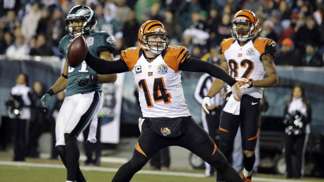 Cincinnati Bengals' Andy Dalton (14) spikes the ball after scoring a touchdown in the second half of an NFL football game against the Philadelphia Eagles, Thursday, Dec. 13, 2012, in Philadelphia. (AP Photo/Mel Evans)