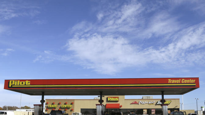 In this Nov. 20, 2013 photo, motorists stop for fuel at a Pilot Travel Center near North Little Rock, Ark. Representatives of the nation's largest diesel fuel retailer are to be in court Monday, Nov. 25, 2013 in Little Rock for a settlement hearing in a $70 million lawsuit by customers who the company acknowledges were cheated out of rebates. Pilot Flying J, owned by Cleveland Browns owner Jimmy Haslam and Tennessee Gov. Bill Haslam, reached an agreement with nearly 6,000 customers who are to be paid with 6 percent interest, if the pact gets final approval. (AP Photo/Danny Johnston)