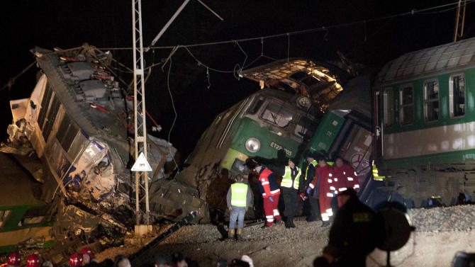 Rescue officials work at the scene where two trains collided in Szczekociny, southern Poland, killing several people and injuring dozens of others, Saturday evening, March 3, 2012.  The head-on collision appears to be one of the worst rail disasters in the country in recent years, officials said.  (AP Photo/ Michal Legierski )  POLAND OUT