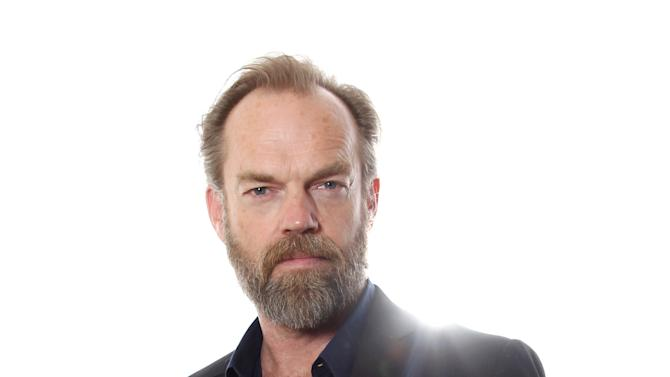 "In this Oct. 14, 2012 photo, Actor Hugo Weaving, from the upcoming film ""Cloud Atlas,"" poses for a portrait in Beverly Hills, Calif. The stars of ""Cloud Atlas,"" along with British author David Mitchell, who wrote the novel that inspired the genre-bending epic about souls returning and intertwining over the centuries, shared their beliefs and disbeliefs about reincarnation as the film heads to U.S. theaters Oct. 26, 2012. Hanks himself doesn't buy into reincarnation, while Berry, Whishaw, Mitchell, Sarandon and co-stars Hugo Weaving and Jim Sturgess either believe or at least think it's possible that souls come back for an encore. (Photo by Matt Sayles/Invision/AP)"