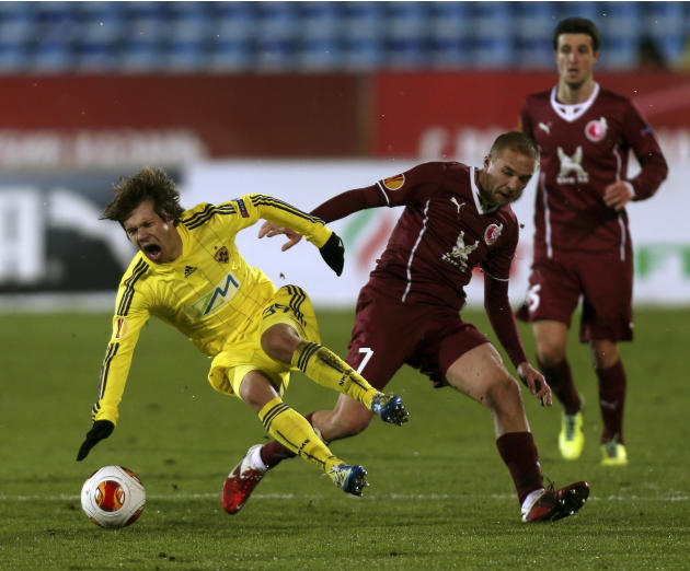 Rubin's Vladislav Kulik, right,  fights for the ball with Maribor's  Damjan Bohar,  during their Europa League Group D soccer match in Kazan, Russia, Thursday, Nov. 28, 2013
