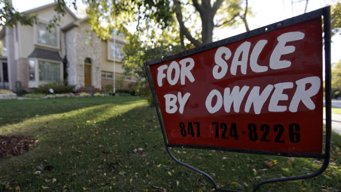 FILE - This Wednesday, Oct. 10, 2012  file photo shows a for-sale sign at a home in Glenview, Ill. Mortgage giant Freddie Mac earned $2.9 billion from July through September, its second straight profitable quarter. The government-controlled company attributed the gain to rising home prices and fewer mortgage delinquencies. (AP Photo/Nam Y. Huh, File)
