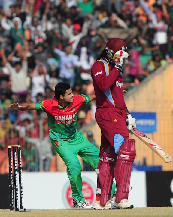 Bangladesh cricketer Mashrafe Bin Murtaza (L) reacts after the dismissal of the West Indies cricketer Chris Gayle during the second one day international cricket match between Bangladesh and the West
