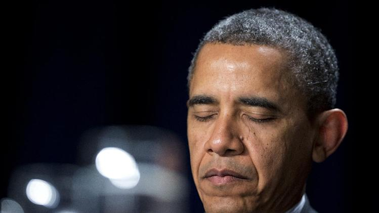 President Barack Obama closes his eyes as he listens to offerings of prayers at the National Prayer Breakfast in Washington, Thursday, Feb. 7, 2013. While speaking, the president said he hopes they maintain the morning's bipartisan spirit a little longer.  (AP Photo/Manuel Balce Ceneta)