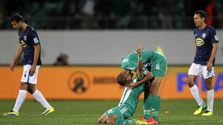 Erraki of Raja Casablanca celebrates winning their FIFA Club World Cup soccer match against Auckland City FC at Agadir Stadium in Agadir