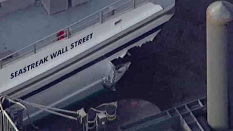 ADDS NUMBER OF PEOPLE INJURED- This aerial photo provided by WABC News Channel 7 shows damage to a commuter ferry in Lower Manhattan, Wednesday, Jan. 9, 2013, in New York. The Fire Department says at least 50 people were injured when a ferry from New Jersey struck a dock during rush hour. (AP Photo/WABC News Channel 7)