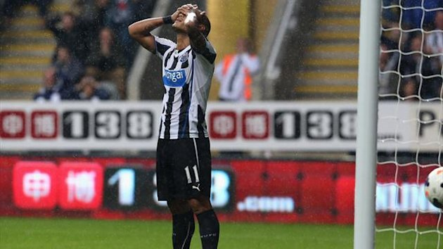 Yoan Gouffran of Newcastle United looks dejected after missing a last minute open goal (Getty Images)