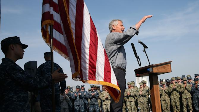"""U.S. Defense Secretary Chuck Hagel speaks to military service members aboard the USS Ponce in Manama, Bahrain, Friday, Dec. 6, 2013. Standing on the massive deck of the Navy's USS Ponce, Hagel said the U.S. is entering the new nuclear pact with Iran """"very clear eyed"""" and it remains to be see whether Tehran is serious about keeping its development peaceful. (AP Photo by Mark Wilson, Pool)"""