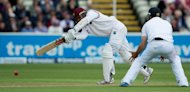 West Indies Denesh Ramdin (L) bats during the third day of the third Test match between England and West Indies at Edgbaston in Birmingham, central England. West Indies, after losing the toss, were 280 for eight at stumps
