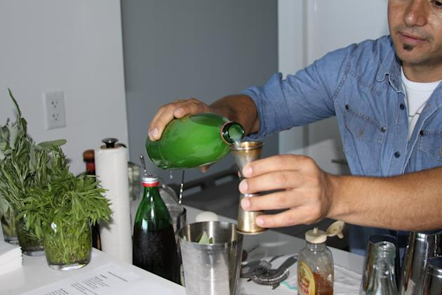2. Add fresh pineapple juice, fresh lime juice, 2 sage leaves and agave nectar into a cocktail shaker.