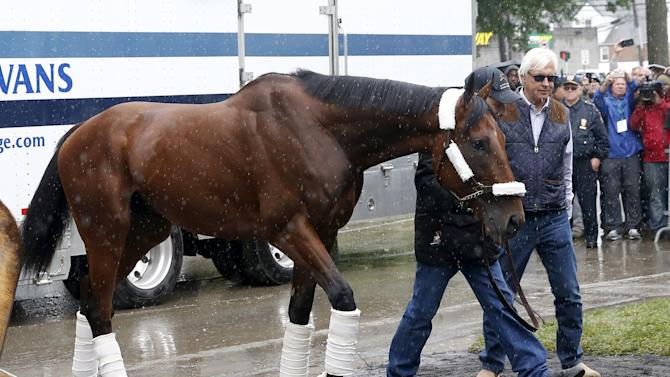 Kentucky Derby and Preakness Stakes winner American Pharoah arrives with trainer Bob Baffert at Belmont Park in Elmont, New York