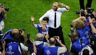 Chelsea's Italian interim manager Roberto Di Matteo (C) makes the victory sign after winning the UEFA Champions League final football match on May 19. He was named permanent manager and first-team coach on a two-year contract Wednesday