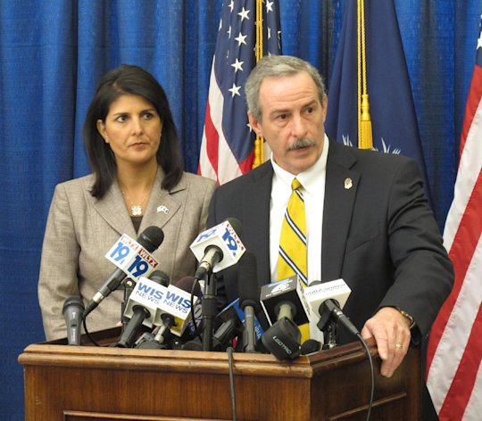 South Carolina Gov. Nikki Haley, left, and State Law Enforcement Division Chief Mark Keel, center, talk about how a hacker gained access to find 3.6 million tax returns from the Department of Revenue, in Columbia, S.C. on Monday, Oct. 29, 2012. Authorities say an international hacker was able to get into the database months ago. (AP Photo/Jeffrey Collins)
