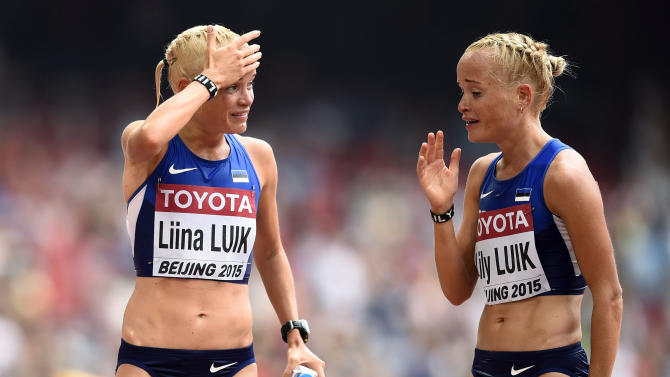 Liina Luik of Estonia talks to compatriot Lily Luik after the women's marathon at the 15th IAAF Championships in Beijing