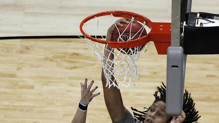 Baylor center Brittney Griner (42) pulls  a rebound away from Notre Dame guard Natalie Novosel (21) during the first half in the NCAA women's Final Four college basketball championship game, in Denver, Tuesday, April 3, 2012.  (AP Photo/David Zalubowski)