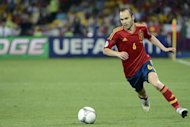 Spanish midfielder Andres Iniesta controls the ball during the Euro 2012 football championships final match Spain vs Italy at the Olympic Stadium in Kiev. &#39;The Greatest&#39; Muhammad Ali once said he &quot;floats like a butterfly and stings like a bee&quot; and now he seems to have found a worthy successor, although not in the ring