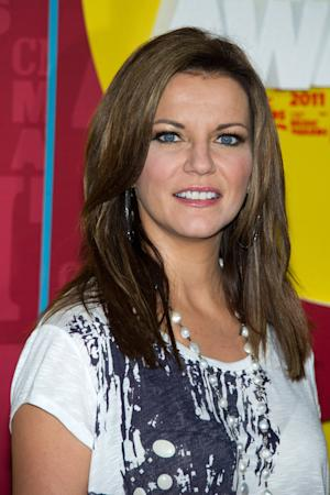 "FILE - In this June 8, 2011 file photo, Martina McBride arrives at the 2011 CMT Music Awards in Nashville, Tenn. McBride is releasing her new album, ""Eleven,"" in  October with a cross-country train ride from Los Angeles to New York.  (AP Photo/Charles Sykes, file)"