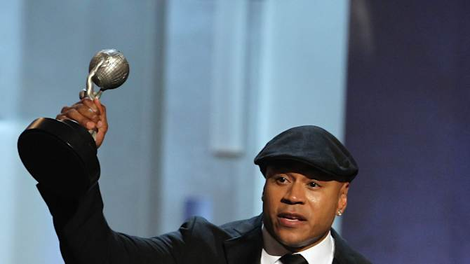 """LL Cool J accepts the award for outstanding actor in a drama series for """"NCIS: Los Angeles"""" at the 44th Annual NAACP Image Awards at the Shrine Auditorium in Los Angeles on Friday, Feb. 1, 2013. (Photo by Matt Sayles/Invision/AP)"""