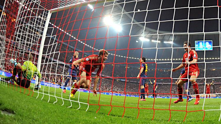 Bayern's Thomas Mueller, third left, celebrates after scoring during the Champions League semifinal first leg soccer match between Bayern Munich and FC Barcelona in Munich, Germany, Tuesday, April 23, 2013. (AP Photo/Kerstin Joensson)