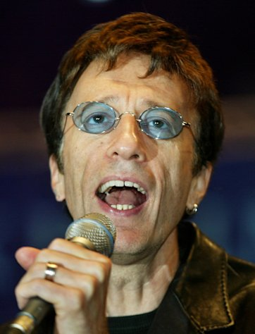 FILE This Saturday, Sept. 25, 2004, file photo shows former Bee Gees singer Robin Gibb, performing a song at the beginning of a show match between former German tennis star Steffi Graf and Argentina&#39;s Gabriela Sabatini at the Max-Schmeling-Halle hall on in Berlin. British media reports said Saturday April 14, 2012 former Bee Gee Robin Gibb is gravely ill with pneumonia in a London hospital. The Sun newspaper reported Saturday that 62-year-old Gibb is in a coma, citing a family friend.(AP Photo/ Jan Bauer)