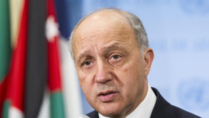 In this March 27, 2015, photo provided by the United Nations, Laurent Fabius, Minister of Foreign Affairs of France, speaks with the media at United Nations headquarters. Fabius said Friday his country will propose a U.N. Security Council resolution in the coming weeks that could present a framework for negotiations toward resolving the Israeli-Palestinian conflict. (AP Photo/United Nations, Rick Bajornas)