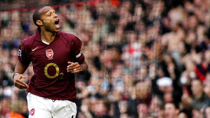 Arsenal's Thierry Henry reacts to a play with teammate Robert Pires during a premiership match against Manchester City at Arsenal's grounds Highbury, October 22, 2005
