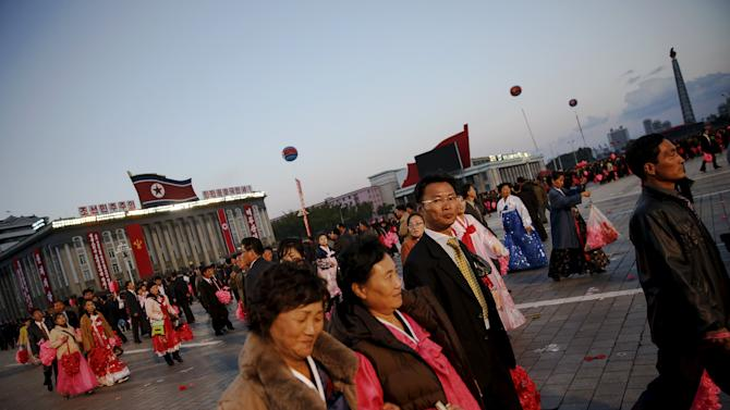 People leave Pyongyang's main Kim Il Sung Square after the parade celebrating the 70th anniversary of the founding of the ruling Workers' Party of Korea