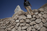 In this photo taken Tuesday, July 19, 2011, a Palestinian worker stands at the archeological park of Tel Balata in the West Bank city of Nablus. Archaeologists unearthing a biblical ruin inside the Palestinian city of Nablus in the West Bank are writing the latest chapter in a 100-year-old excavation that has been interrupted by two world wars and numerous rounds of Mideast upheaval. (AP Photo/Bernat Armangue)
