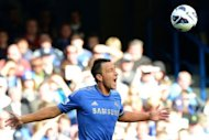 Chelsea's English defender John Terry heads the ball during their English Premier League football match against Norwich City at Stamford Bridge in London. Chelsea won 4-1